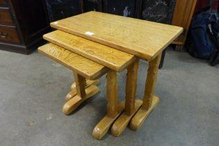 A Robert Thompson style oak nest of tables