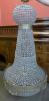A large French Empire style gilt metal and glass bag shaped chandelier, approx. 160cms h