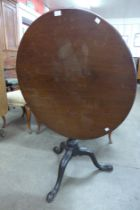 A George IV mahogany circular tilt top tripod tea table