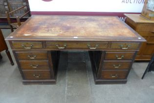 A George III style mahogany pedestal library desk