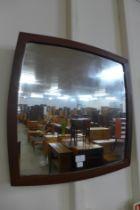 A teak framed mirror