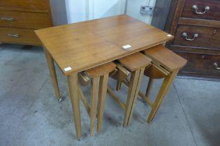 A teak nest of tables