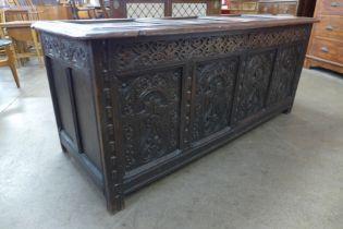 A Charles II carved panelled oak coffer