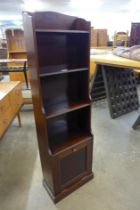 An Art Deco mahogany bookcase/newspaper stand