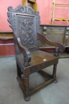 A 17th Century style carved oak Wainscot chair