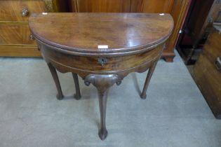 A George I mahogany demi-lune tea table