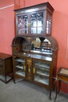 An Art Nouveau inlaid mahogany side cabinet, 207cms h, 122cms w, 41cms d