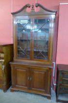 A George III style inlaid mahogany astragal glazed bookcase