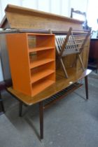 A teak coffee table, an oak folding magazine rack and one other