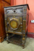 A Jacobean Revival carved oak and walnut geometric side cabinet