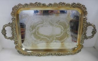 A large silver plated two handled tray with cast metal edge, 51cm