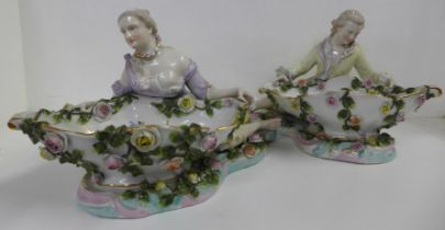 A pair of 19th Century Sitzendorf porcelain figural sweetmeat dishes, 33cm wide