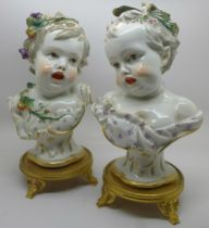 A pair of late 19th Century Meissen porcelain busts of young children on gilt bronze bases, 25cm