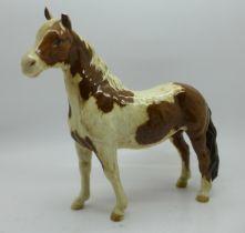 A Beswick Pinto Pony, left ear chipped
