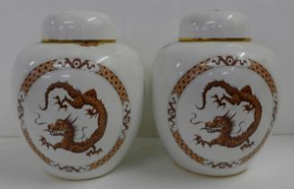 A pair of Carlton Ware ginger jars decorated with oriental dragons, 22cm