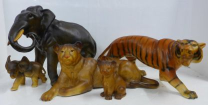 A Melba Ware model tiger, lion and cub, a model elephant and elephant calf, one elephant tusk