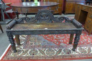 A Victorian Jacobean Revival carved oak window seat