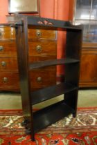 An Arts and Crafts oak open bookcase