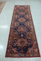 A north west Iranian red ground runner rug, 298 x 95cms