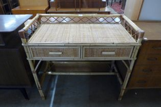 A bamboo and rattan two drawer desk