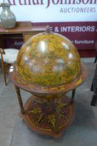 A terrestrial globe cocktail cabinet/trolley