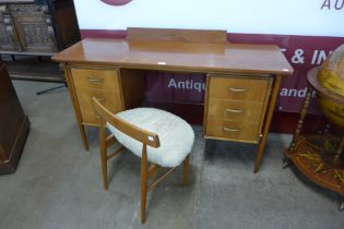 A teak and walnut desk and a chair