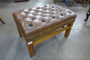 A mahogany and tan buttoned leather footstool