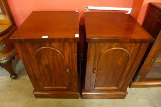 A pair of Victorian mahogany pedestal cabinets