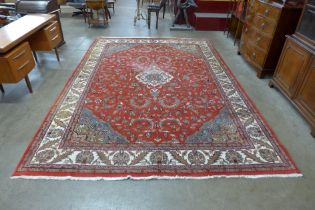 A large red ground rug, 353 x 247cms