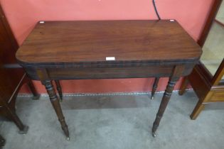 A George IV mahogany D-shaped fold over tea table