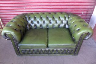 A Chesterfield green buttoned leather settee
