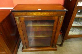 A Victorian inlaid walnut pier cabinet