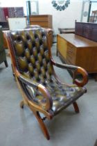 A Regency style mahogany and olive green buttoned leather armchair