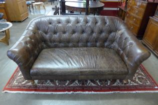 A Chesterfield style chestnut brown buttoned leather settee