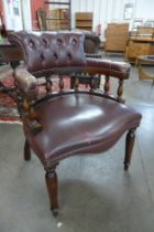 A mahogany and burgundy leather desk chair