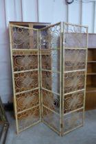 A bamboo and wicker three panel folding screen