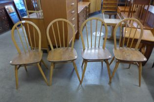 A set of four Ercol Blonde elm and beech Windsor chairs