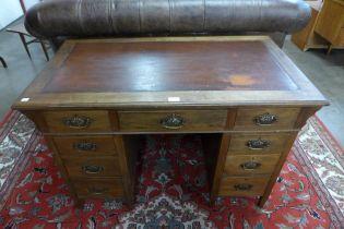 An Arts and Crafts mahogany pedestal desk