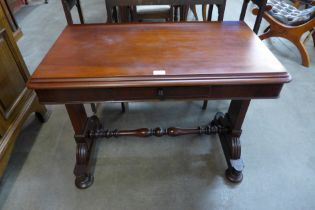 A Victorian mahogany single drawer stretcher table