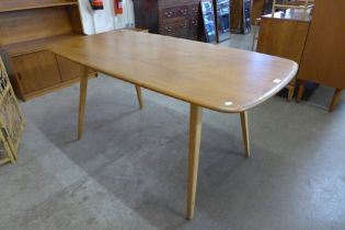 An Ercol Blonde elm and beech plank top dining table