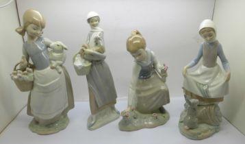 Four Lladro figurines; Girl with Lamb model no. 4835, designer Juan Huerta, Rabbits Food model no.