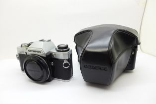 An Olympus OM 10 Body with manual adapter Olympus Body Cap and case