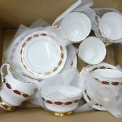 A Paragon Elegance tea service comprising six cups, saucers, side plates and one bread and butter