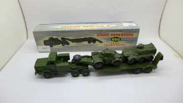 A Dinky Supertoys 660 tank transporter and two other military vehicles