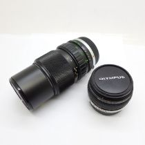 An Olympus f4 75-100mm and Zuiko Olympus f1.8 50mm Zuiko lenses, with caps