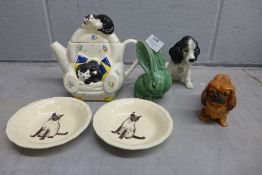 A Royal Doulton Pekinese, Sylvac dog, Bourne Denby rabbit, a pair of Siamese cat dishes and a