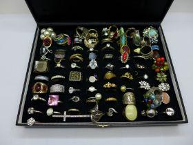 Approximately ninety costume rings, boxed