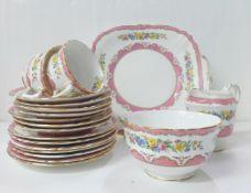 A Staffordshire fine bone china set comprising five cups, seven plates, a milk jug, seven saucers, a