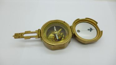 A reproduction Stanley London brass compass