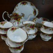A Royal Albert Old Country Roses tea service comprising; a teapot, sugar bowl, milk jug, six cups,